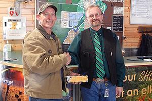 Wetland Wonders Challenge winner Scott Irwin shakes hands with DNR Wildlife Division chief Russ Mason