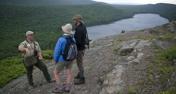 A DNR state park interpreter talks with visitors at Porcupine Mountains Wilderness State Park in the U.P.