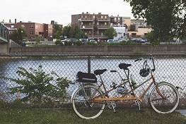 A tandem bike is parked in front of the River Raisin - City of Monroe