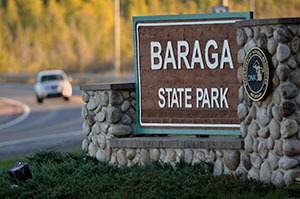 The sign at the entrance to Baraga State Park is shown.