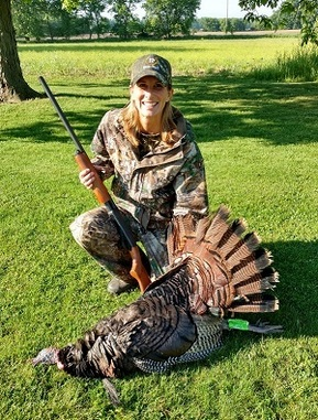 Michigan DNR's new natural resources deputy Shannon Hanna after a successful turkey hunt