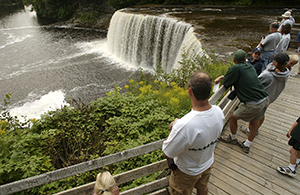 Visitors enjoy the Upper Falls at Tahquamenon Falls State Park in the eastern Upper Peninsula.