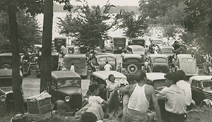 Automobiles and state parks became popular together as is shown here at Island Lake State Park.