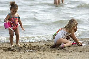 Beachgoers enjoy Dodge #4 State Park in Oakland County.