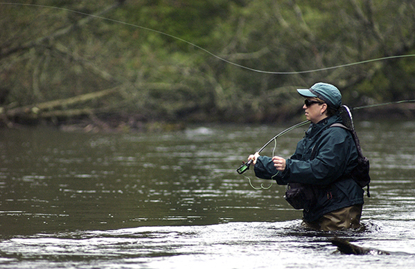 An angler fishes on the storied trout waters of the AuSable River.
