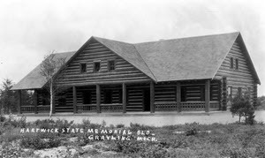 Historic black and white photo of exterior of the Hartwick Pines Memorial Building, c. 1929.