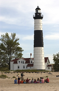 Group gathered outside of Ludington State Park lighthouse