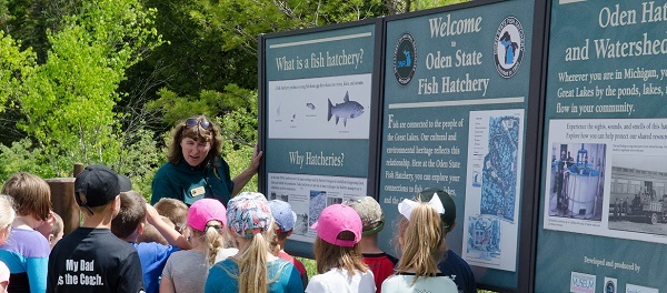 A group of students on a field trip to Oden State Fish Hatchery learn about how the hatchery raises fish