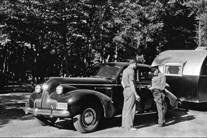 An early park photo show vehicle check-in at a Michigan state park.