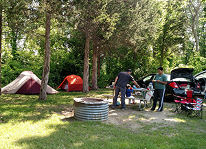 Campers enjoy the day at Oakland County's Proud Lake State Park in 2018.