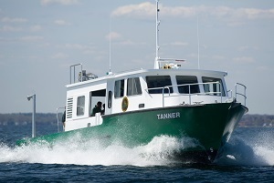 The DNR's research vessel Tanner cutting through the water