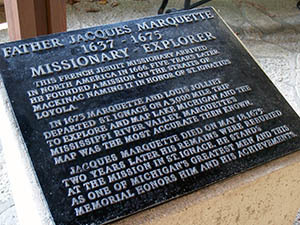 A marker honors Father Jacques Marquette at the national memorial site in Mackinac County.