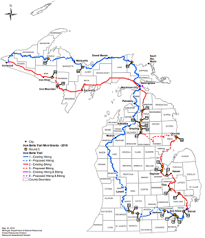 black and white Michigan map, showing Iron Belle Trail hiking, biking routes, plus numbered locations of 2019 mini-grant funded projects