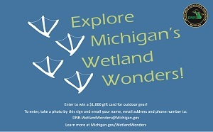 Wetland Wonders Contest blue sign with white bird tracks