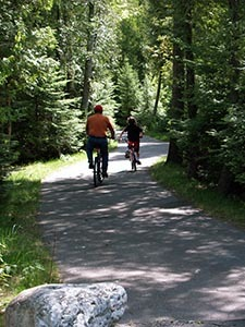 Park visitors enjoy a bike ride along a trail at Indian Lake State Park.