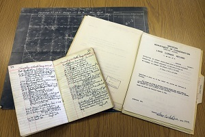 Early surveying books and records used in Department of Conservation land and forestry efforts
