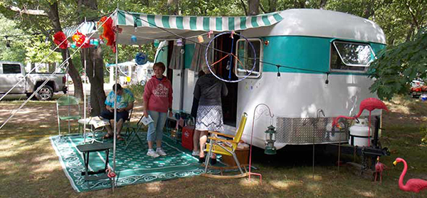 vintage camper and owner at campground