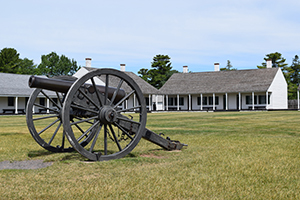 Historic cannon on the parade grounds at Fort Wilkins Historic State Park.