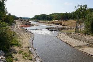 Construction crews work to remove the Boardman Dam along the Boardman River