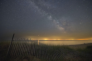 beach and starry sky at sunset