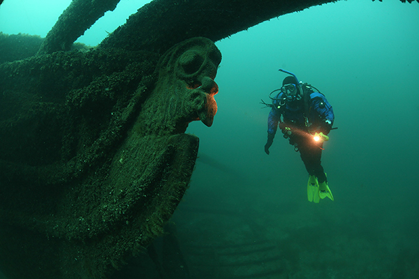 Dan Friedhoff of the Michigan Underwater Preserves Council dives on the wreck of the Sandusky.