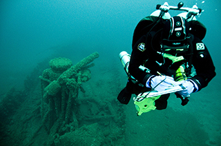 A researcher studies the shipwreck of the steam barge Messenger.