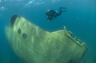 A diver at Thunder Bay National Marine Sanctuary near Alpena photographs the wreck of the German freighter Nordmeer.