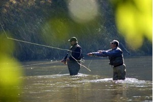 two men fly-fishing in a river