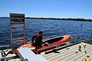 kayaker uses accessible launch