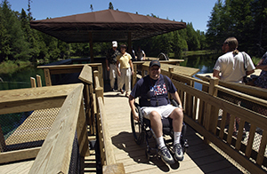 wheelchair user leaving observation raft at Big Spring