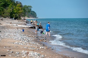 People enjoying the beach at Muskallonge State Park in Luce County, Michigan's Upper Peninsula