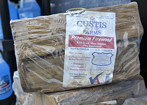 bundle of firewood with USDA certification stamp