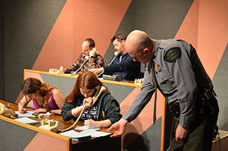 "A conservation officer looks at viewer questions during a broadcast of ""Ask the DNR."""