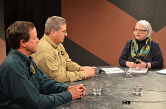 "A pair of biologists listen to a question from the host of ""Ask the DNR."""