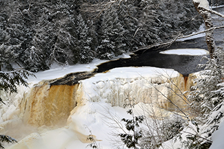 The Upper Tahquamenon Falls are shown during wintertime.