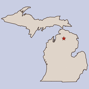 line art map of Michigan's two peninsulas, with a red star denoting a location in Otsego County