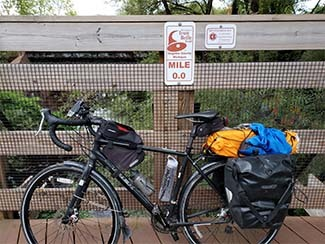 A bike leans against a rail at mile zero of the Iron Belle Trail in Gogebic County.