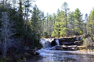 The Baltimore River plunges over a rock ledge at O Kun de Kun Falls in Ontonagon County.