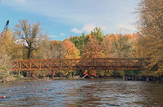 An Iron Belle Trail pedestrian bridge over the Huron River is shown in Washtenaw County.