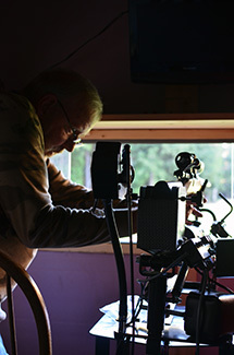 Ken Buchholtz adjusts a mechanism in one of the hunting trailers.