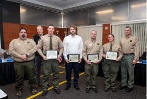 Several DNR Parks and Recreation employees and supervisors pose with their lifesaving award plaques