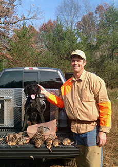 Hunter Dave Wildrom of Grand Haven and his dog, Holly are shown after a successful woodcock hunt.
