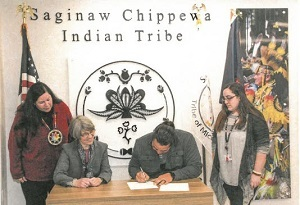 signing the MOU for co-management of Sanilac Petroglyphs Historic State Park