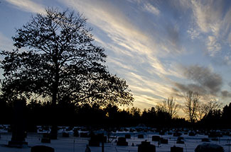Sunset descends behind a cemetery in western Marquette County.