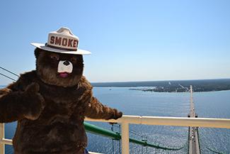 Smokey Bear stands atop the Mackinac Bridge.