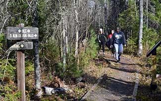 Three women walk along a restored trail.