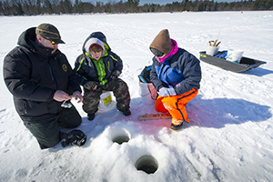 instructor teaches ice fishing skills