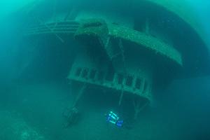 A diver swims around the Cedarville shipwreck