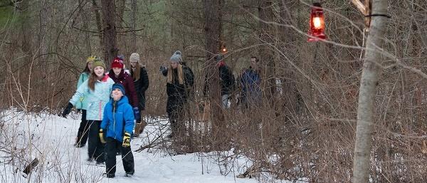 enjoying a lantern-lit ski and showshoe hike at Island Lake Recreation Area, winter 2019