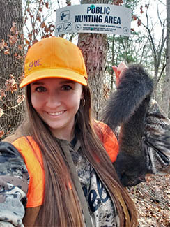 Hunter Heather Iverson is pictured with a squirrel after a successful hunt.